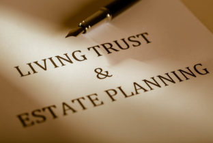 "Fountain Pen Lying On The ""Living Trust And Estate Planning"" – Close Up"