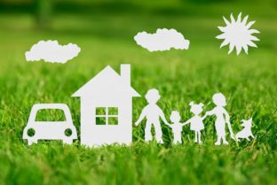 Paper Cut Of Family With House And Car On Green Grass